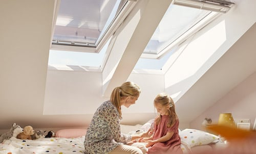 mother and daughter bonding in the attic