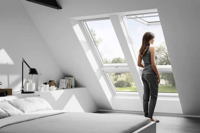 girl in her room at the attic with velux from skydome hunter coast